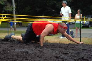Competitors Get Dirty During Family Mud Race in Woodland Park