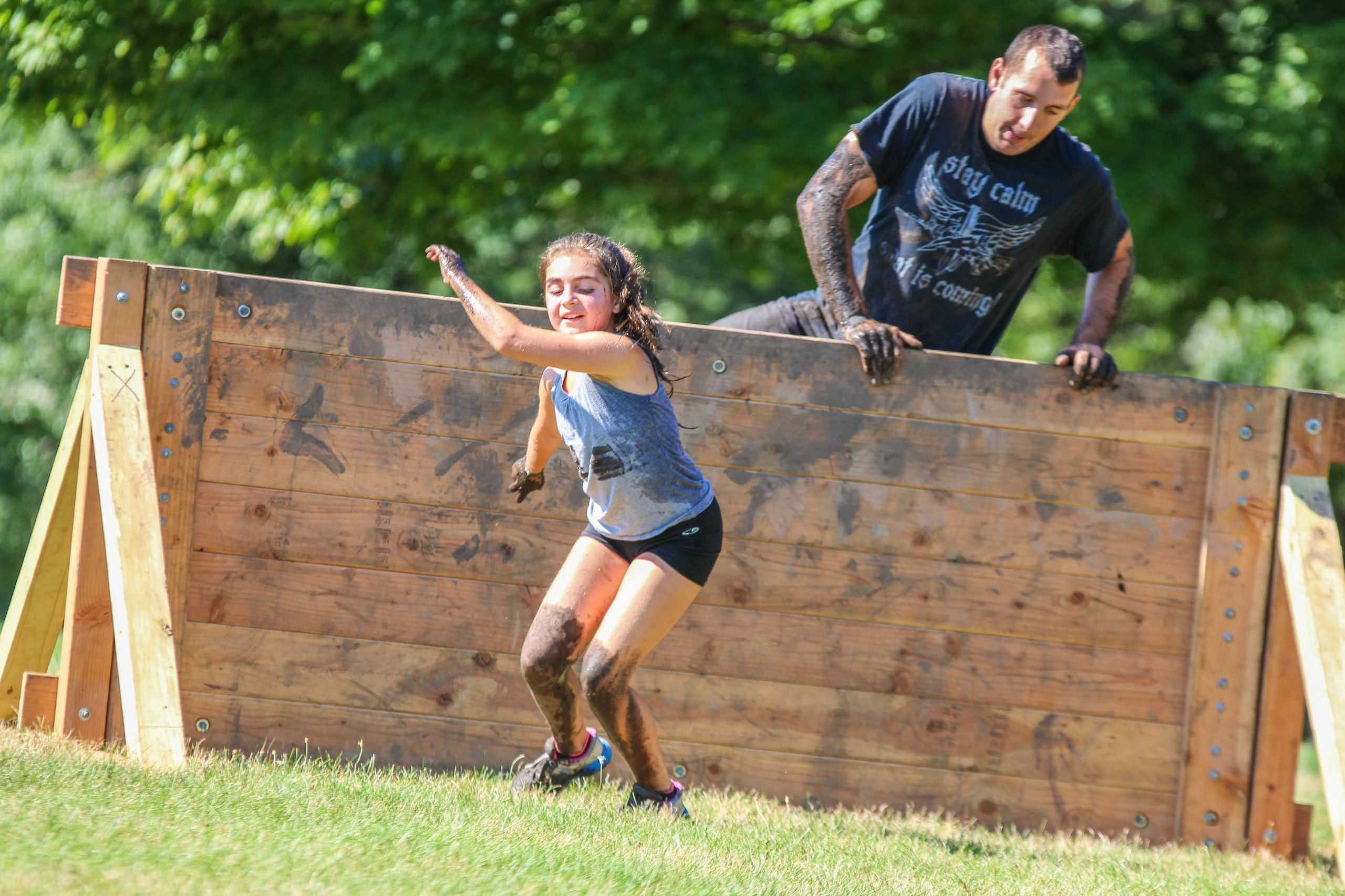 family mud run wall jump in MA